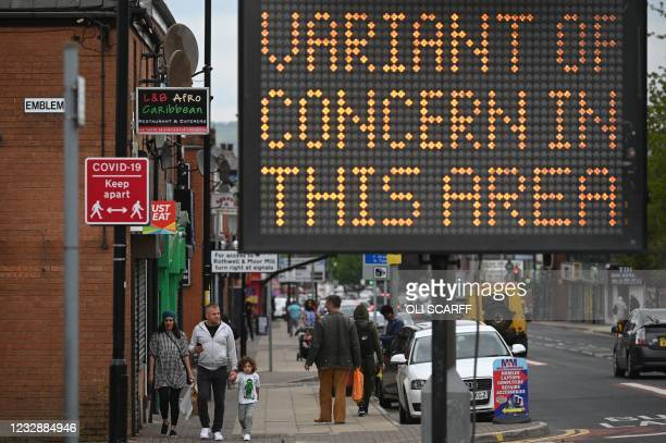 Public health digital board warns the public of a Covid-19 variant of concern affecting the community in Bolton, northwest England on May 14, 2021. -...