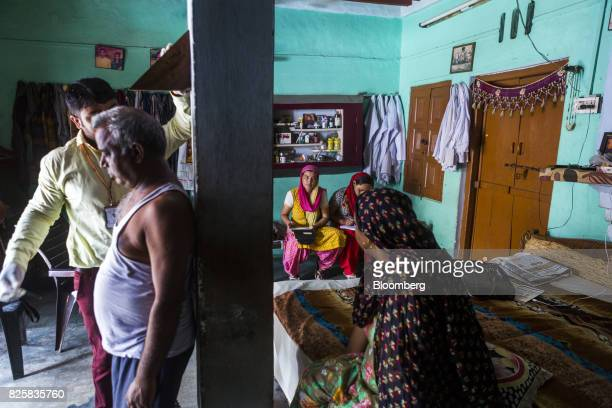 Public Health Foundation of India workers measures the height of a patient during a free doortodoor screening program funded by Eli Lilly Co at a...