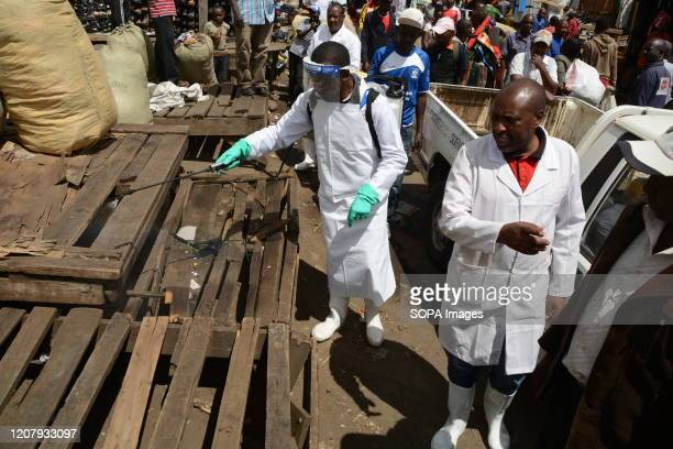 A public health officer fumigates part of Gikomba market in Nairobi as a preventive measure against covid19 The Kenyan government has banned all...