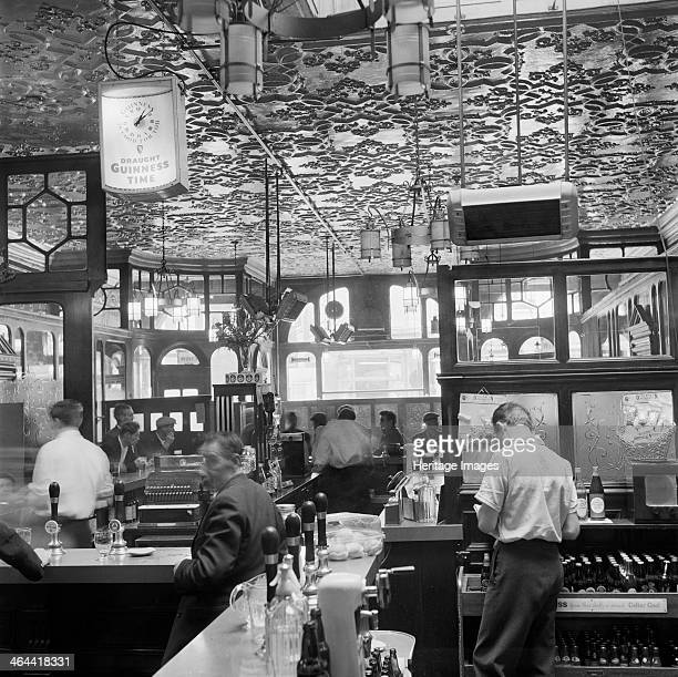 Public house Edgware Road London 19601965 The ornate interior of a public house on Edgware Road with customers standing at the bar and waiting to...