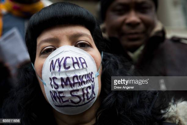 Public housing residents and their supporters rally to demand New York City Housing Authority conditions be improved outside of City Hall February 15...