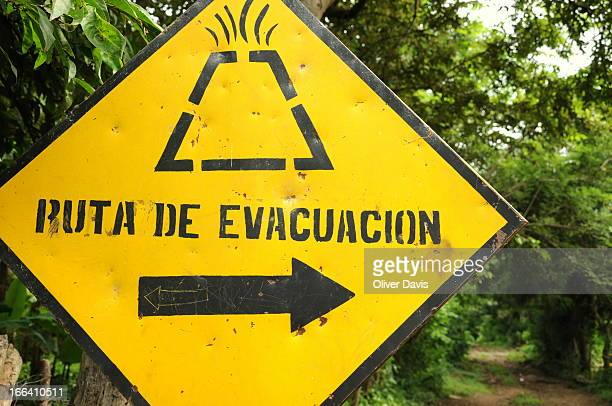 Public information street sign showing the direction of route for an emergency evacuation in the case of a volcanic eruption/disaster. Location:...