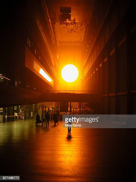 Public interact with the Weather Project by Danish artist Olafur Eliasson at Tate Modern In this installation representations of the sun and sky...