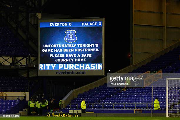 A public notice is displayed on the scoreboard after the match is postponed due to the weather before the Barclays Premier League match between...