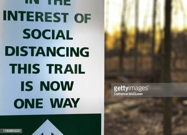 public park covid-19 social distancing information sign - department of health stock pictures, royalty-free photos & images