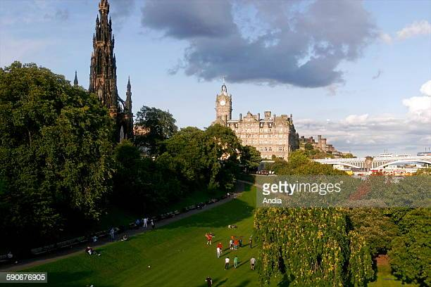 Public park of Edinburgh in Scotland and view of the Balmoral hotel and the Scott Monument