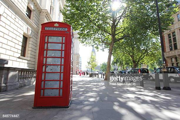 Public Phone Booth By Road And Buildings