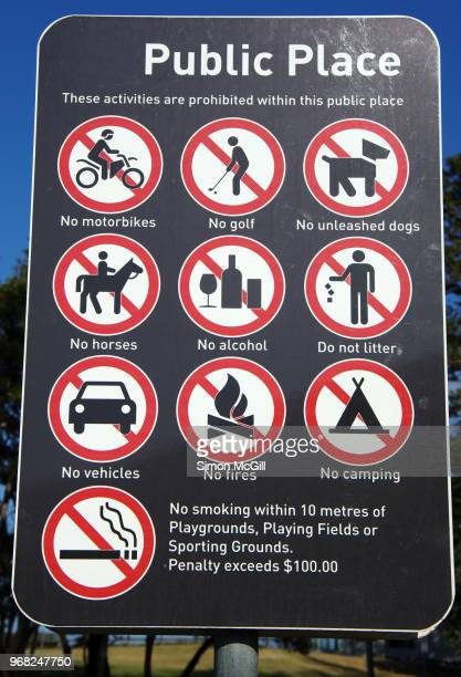 public place sign shows activities prohibited within a public park - australia fires horse stock photos and pictures
