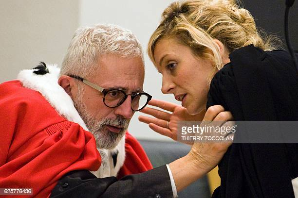Public prosecutor Raphael Sanesi speaks with Marie Grimaud lawyer of the civil party after the verdict on the 10th day of the trial of Cecile...