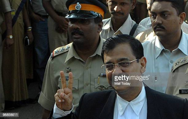 Public prosecutor Ujjwal Nikam smiles as he speaks with media outside the special court set up for the trial of Pakistani Mohammed Ajmal Kasab in...