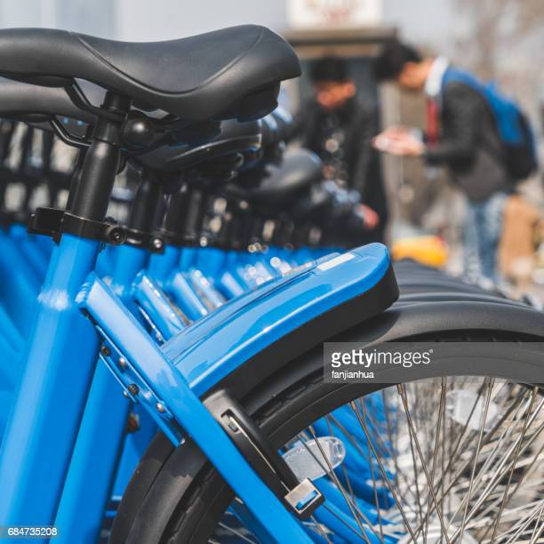 public rental bicycles in a line - pedal stock pictures, royalty-free photos & images