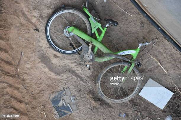 public rental bikes are thrown in the trench, tel aviv - israel - ditch stock photos and pictures