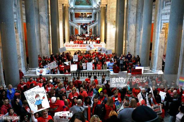 Public school teachers and their supporters protest against a pension reform bill outside the senate chambers at the Kentucky State Capital April 2...