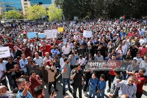 Public school teachers gather for a demonstration demanding pay raises at the Professional Associations Complex in Jordan's capital Amman on October...