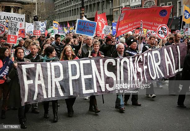 Public sector strikers carrying a banner reading 'FAIR PENSIONS FOR ALL' on the day of the public sector strike on November 30, 2011. There are also...