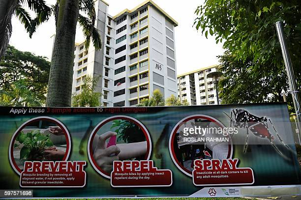 A public service announcement banner against the spread of Aedes mosquitoes a carrier for the Zika virus is seen at a residential block at Aljunied...