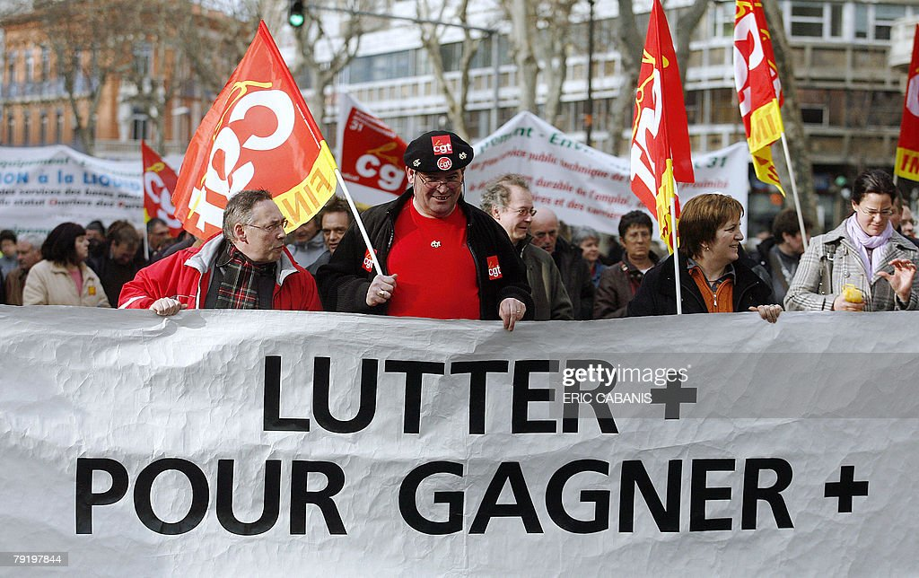 Public service employees demonstrate, 24 January 2008 in Toulouse, to protest against jobs cuts and low wages. Seven of the eight unions representing France's 5.2 million state employees called for the one-day strike and protest marches in Paris and other cities. A banner reads 'To Fight more to earn more'.