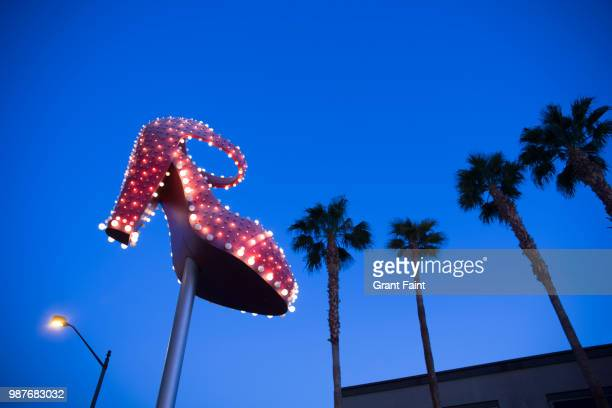 public sign of old style sign. red slipper - las vegas stock pictures, royalty-free photos & images