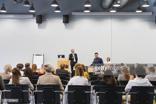 public speaker at a conference - attending stock pictures, royalty-free photos & images