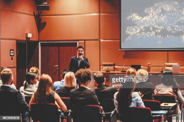 public speaker at marketing seminar - business conference stock pictures, royalty-free photos & images