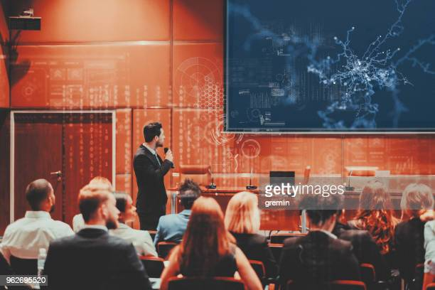 public speaker at science convention - auditorium stock pictures, royalty-free photos & images