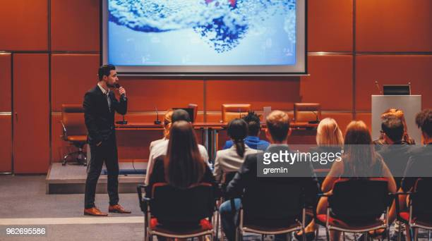 public speaker at science convention - presentation stock pictures, royalty-free photos & images