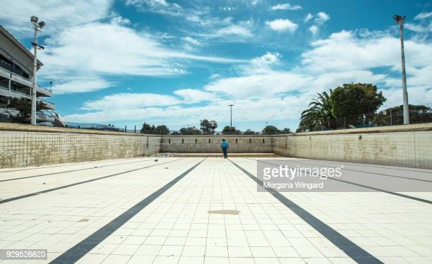 AFRICA MARCH 6 2018 Public swimming pool Swembad Athlone Pool in a suburb of Cape Town has been emptied due to local water restrictions The plant...