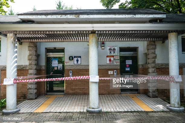 Public toilet in a park is closed off with red tape because of coronavirus pandemic crisis South Korea reported 320 more cases of Coronavirus as of...