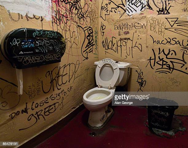 public toilet with graffiti on wall - public restroom stock pictures, royalty-free photos & images