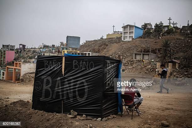 Public toilets are seen at the Nueva Esperanza cemetery Villa Maria del Triunfo district during the Day of the Dead celebrations in Lima Peru 01...