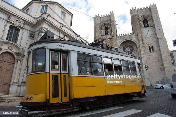 A public tram passes Lisbon cathedral in Lisbon Portugal on Sunday March 4 2012 Portugal in April became the third euroarea country after Greece and...