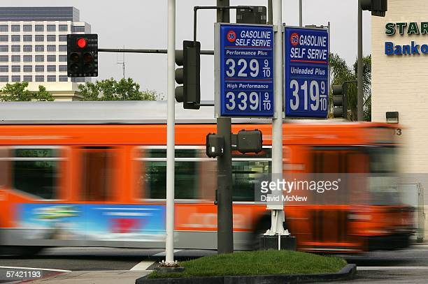A public transit bus passes a gas station advertising prices that are typical of the area well above the $3 per gallon mark on April 25 2006 in the...