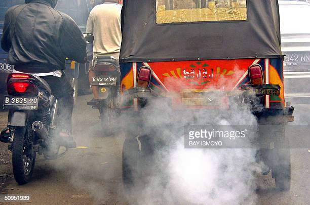 Public transport belches out smoke in a Jakarta main street 12 June 2004 Air quality in the chaotic capital was in the healthy range for only seven...