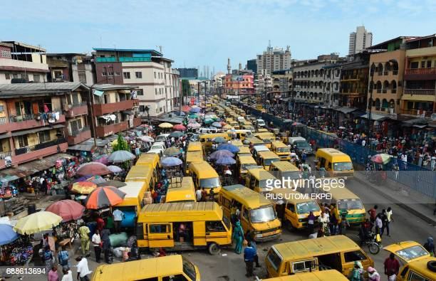 TOPSHOT Public transport minibuses painted in bright yellow colour popularly called Danfo barricade the roads in search of passengers and causing...