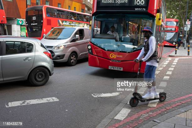 Public transport TFL buses and an escooter at Elephant and Castle in London UK The area is now subject to a masterplanned redevelopment budgeted at...
