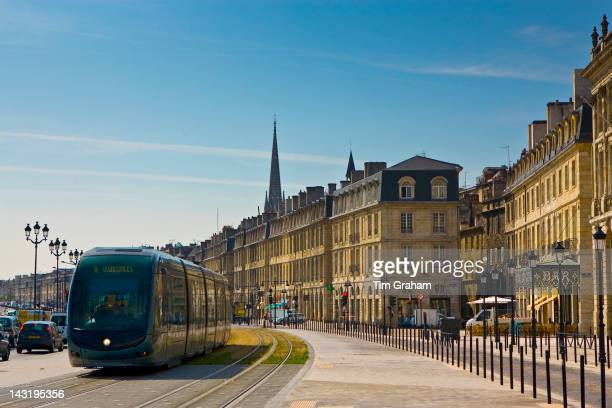 Public transport tram system runs in old Bordeaux France