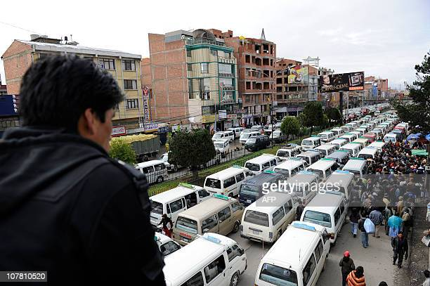 Public transport vans and buses block a main avenue of El Alto 12 km from La Paz minutes before resuming their work on December 29 2010 Two powerful...