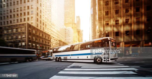 public transportation bus in new york - bus stock pictures, royalty-free photos & images