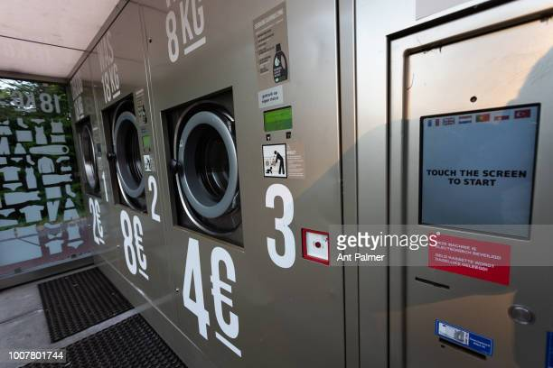Public usage washing machines stand behind a Total petrol station on July 25 2018 in The Hague Netherlands