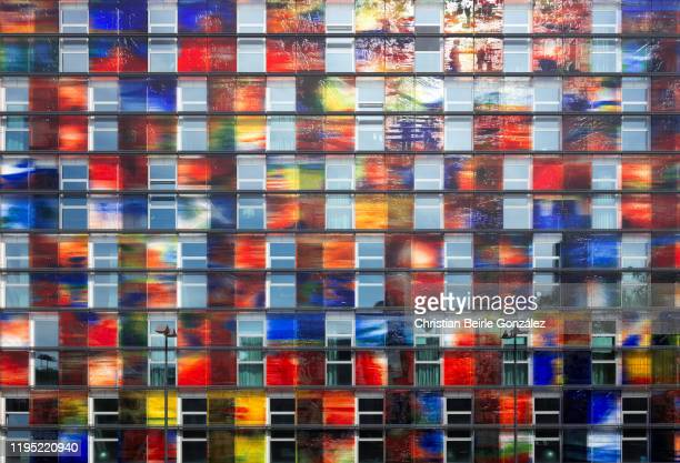 public view on multi-colored vibrant facade of the netherlands institute for sound and vision, hilversum, netherlands - christian beirle gonzález stock pictures, royalty-free photos & images