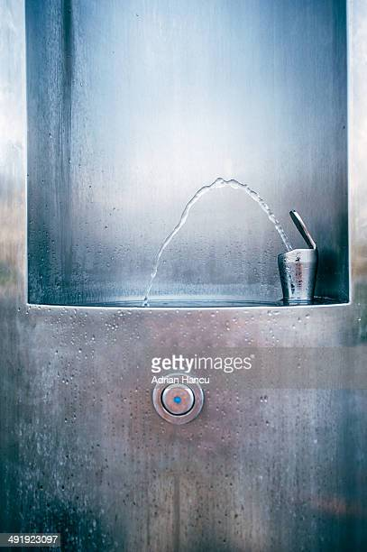 Public water drinking fountain in the city
