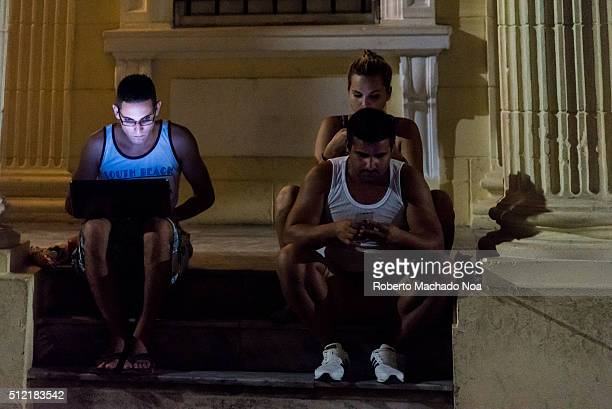 Public Wifi Young people with laptops and cell phones going outdoors to enjoy the new and much needed internet hotspots of the Cuban city