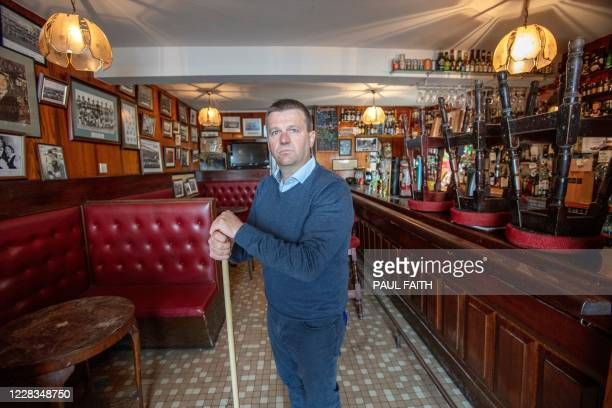Publican Joe Sheridan poses for a photograph in his closed pub, Walsh's bar, in the rural village of Dunmore, west of Ireland, on September 3, 2020....