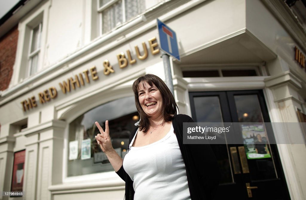 Publican Karen Murphy poses outside her pub The Red White & Blue on October 4, 2011 in Portsmouth, England. Karen Murphy, fined nearly £8000 GBP for using an imported Greek satellite decoder to save money on subscription fees to UK based providers screening Premier League matches, has won her legal battle after she took her case to the European Court of Justice who ruled that licences based on a territory by territory basis contravened EU law.