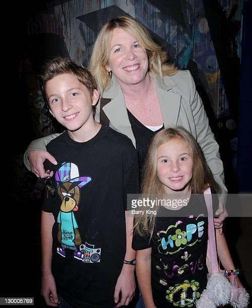Publicist Cheryl Lynch and her son Tristan Swordes and daughter Tabitha Swordes attend Garrett Backstrom's 16th birthday celebration at Racer's Edge...