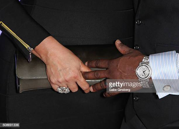 Publicist Elizabeth Randleman ring purse detail and her husband former mixed martial artist Kevin Randleman watch detail attend the eighth annual...