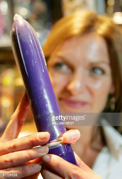 Publicist Fiona Hatten displays the world's first vibrating condom which was launched at SEXPO 2004, the world's biggest adult lifestyle exhibition,...