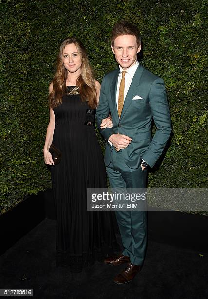Publicist Hannah Bagshawe and actor Eddie Redmayne attend the Charles Finch and Chanel PreOscar Awards Dinner at Madeo Restaurant on February 27 2016...