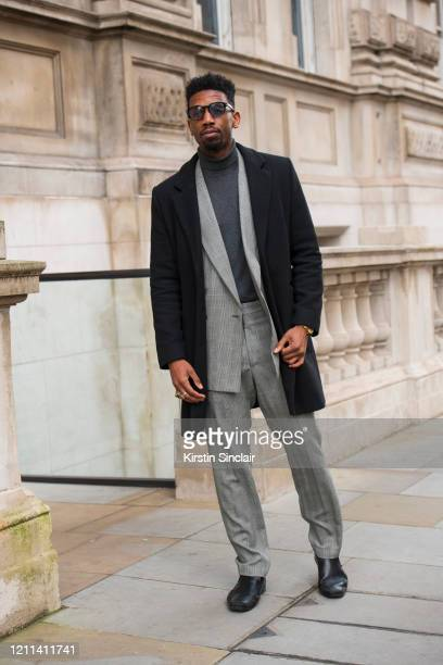Publicist Joe Hagan wears a Versace suit Asos coat Ted Baker shoes Tom Ford sunglasses during London Fashion Week February 2020 on February 18 2020...