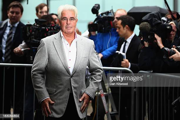 Publicist Max Clifford speaks to the press after leaving Southwark Crown court on October 4 2013 in London England Max Clifford pleaded not guilty...